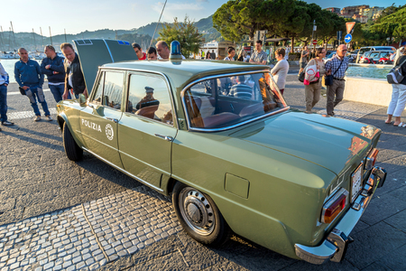 alfa: LERICI, ITALY - MAY 30, 2015: Italian Police 1971 Alfa Giulia famous car on display in Lerici, Italy. In the 1960s Alfa Romeo became famous for its cars specifically designed for the Italian police and Carabinieri.