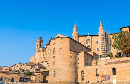 urbino: Urbino, Italy - August 13, 2015: view of skyline with Ducal Palace in Urbino, Italy. The historic center of Urbino was represents the zenith of Renaissance art and architecture.