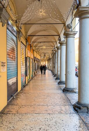arcades: Bologna, Italy - December 27, 2015: day view of Bolognas passage way. In total, there are about 38 kilometres of arcades in the citys historical centre In Bologna, Italy.
