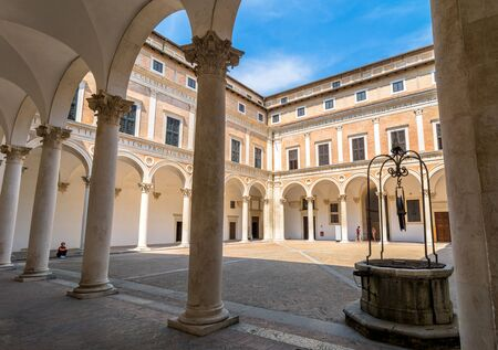 urbino: Urbino, Italy - August 14, 2015: Ducal Palace courtyard with tourists in Urbino, Italy.
