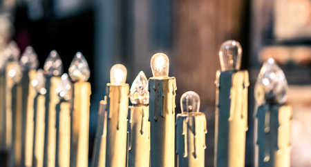 selective focus on row of candles inside a church Stock Photo