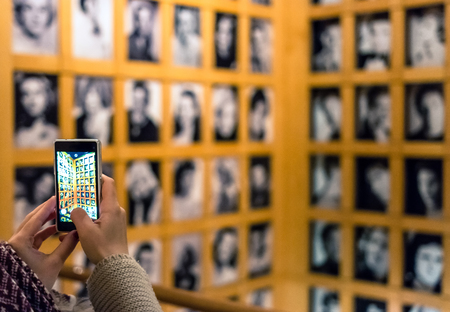 Turin, Italy - January 01, 2016: tourist takes picture with smartphone at National Museum of Cinema in Turin, Italy. The Museum is one of the most important of its kind in the world.