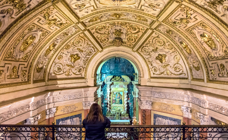 Turin, Italy - January 2, 2016: woman praying inside Santuario della Consolata in Turin, Italy. It is a prominent Marian sanctuary and minor basilica in central Turin, Piedmont, Italy.