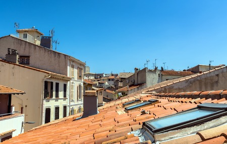 Antibes, France - June 26, 2016: day view of old town roofs and skyline in Antibes, France. It is one of the most well known resorts on the Cote dAzur, located between Nice and Cannes.