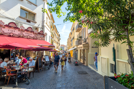 Antibes, France - June 27, 2016: day view of main street Rue de la Republique with tourists in Antibes, France. Antibes is a popular seaside town in the heart of the Côte dAzur.