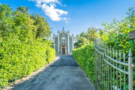 small San Venanzio Abate rural church in Busana, Emilia Apennines, Italy Stock Photo