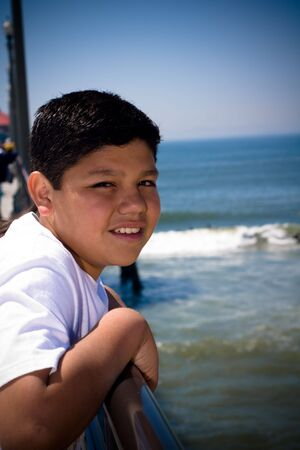 a young hispanic boy at the pier Stock Photo