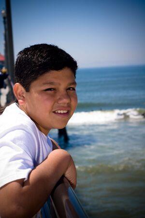 a young hispanic boy at the pier Standard-Bild