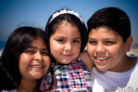 mexican dress: a hispanic family takes a shot together at the beach