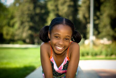 american content: young african american girl smiling in the shade
