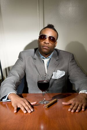 merlot: young african american adult in suit with a glass of merlot and a cigar