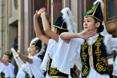kazakh: Kazakh dancers performing in national clothes on Nauryz spring holiday in Almaty, Kazakhstan
