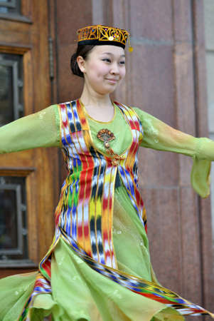 kazakhstan: Uzbek dancer performing in national clothes on Nauryz spring holiday in Almaty, Kazakhstan