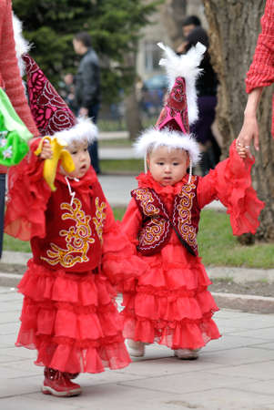 Kazakh children in national clothes on Nauryz spring holiday in Almaty, Kazakhstan Editorial