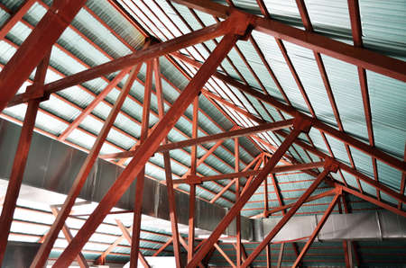 Space under roof trusses in newly-built house photo