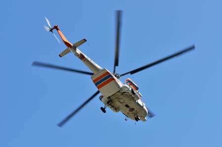 17: Russian helicopter Mi-171 flying on the blue sky