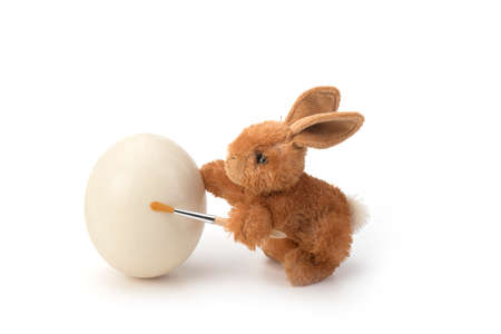 Easter Rabbit decorates an egg