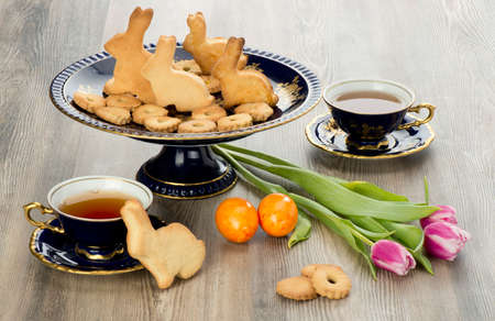Easter homemade gingerbread cookies and tea cup with flowers