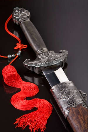 Blade of Japanese sword Chinese made symbol red gripe Stock Photo