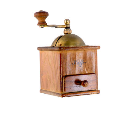 Very old antique coffee grinder with a bronze handle and box for ground coffee on a white background and from different sides