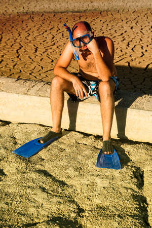 snorkelers: a boy with snorkel and fins in the field
