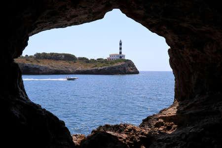 Rock window with lighthouse - Porto Colom Mallorca Balearic Islands Spain