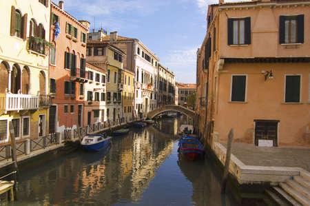 a venetian canal, Venice, italy photo