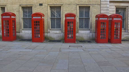 aligned red london phone booths