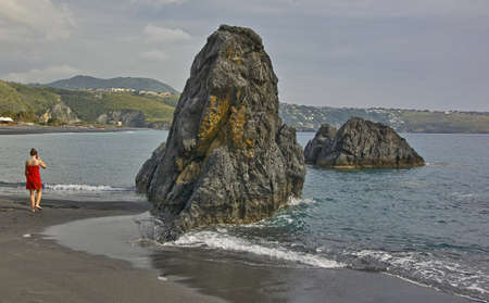 onshore: Offshore rocks formations in the mediterranean sea in Italy Stock Photo