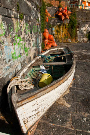 boat on the coastline in the city of naples, italy Stock Photo