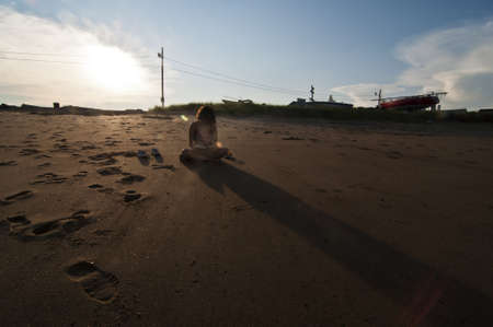 woman on the beach in Maine, Usa