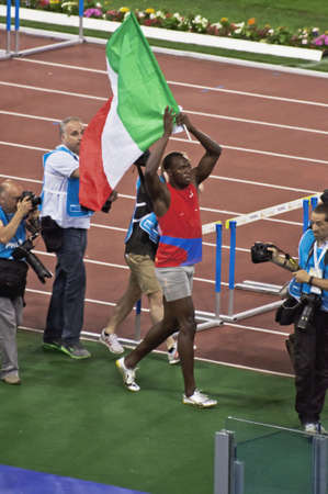 ROME . May 31: Usain Bolt making victory lap after winning 100 m speed race at Golden Gala in the Olympic Stadium on May 31, 2012 in Rome Editorial