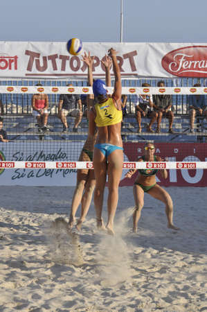 NAPLES - JULY 07: italian professional players have a competition at Italian beach volley female tournament on July 07, 2012 in Naples Italy
