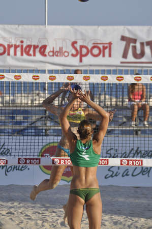 NAPLES - JULY 07: italian professional players have a competition at Italian beach volley female tournament on July 07, 2012 in Naples Italy Stock Photo - 14418509