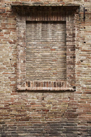 walled window of tuscan rural house, italy