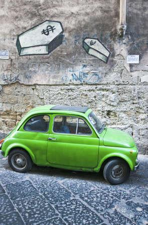 nice green Fiat 500 in a italian street