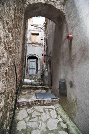 narrow street in an italian small village photo