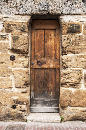 door of the old building in italian village of tuscany, italy