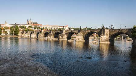 view of the Charles Bridge on the Vltava river in Prague photo