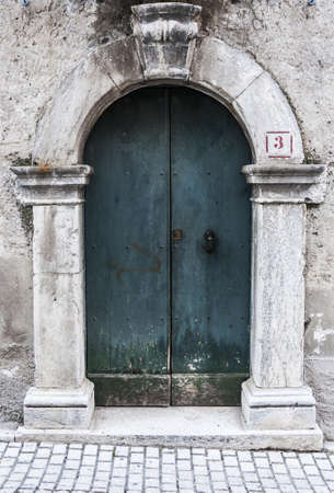 italian door in small village, Italy photo