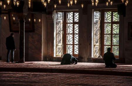 muslims praying in istanbul mosque, turckey