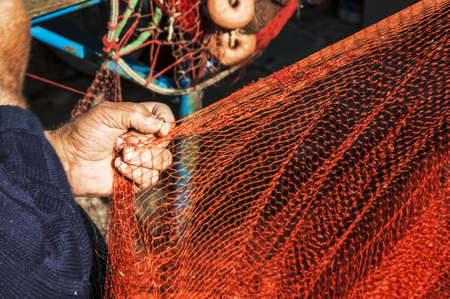 colored fishing net in a small harbor Stock Photo - 18338072