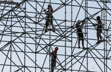 costruction: a group of men working on a costruction