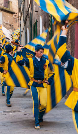 palio: flag-flyers before the Palio in Siena, Italy