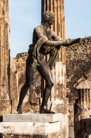 bronze statue inside the pompeii ruins, italy photo