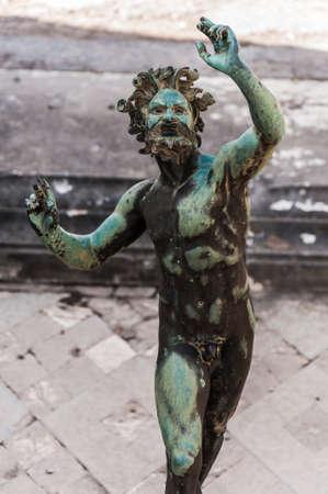 the Fauno bronze statue inside the pompeii ruins, italy photo