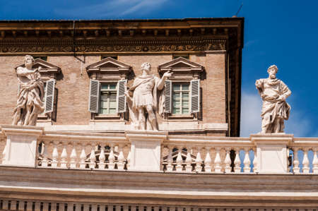 a group of saint statues on the Bernini Columnate in St  Peter Stock Photo