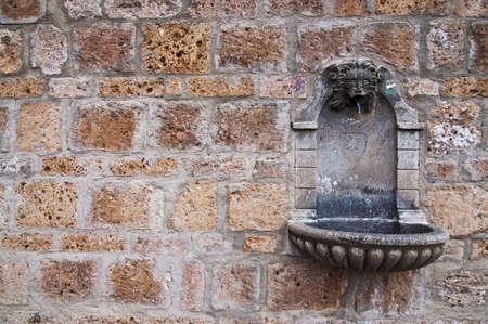 italian fountain: detail of an old fountain in italian village