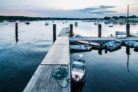 ellis: pier and boats at susnet in Camp Ellis, Maine Usa