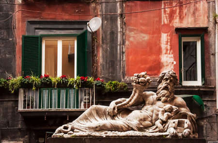 the Nilo Statue downtown the city of Naples, Italy 写真素材